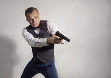 Spy agent with a gun Royalty Free Stock Photo