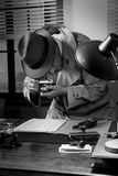 Spy agent stealing top secret data. And taking pictures, 1950s style office Royalty Free Stock Photos