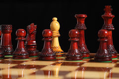 Spy bishop on the chessboard. With a black background Stock Photo
