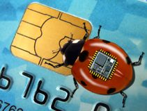 Spy bug. Takes data from the chip plastic credit card Royalty Free Stock Photos