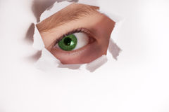 Spy eye looking through paper hole. curious and nosy child Royalty Free Stock Photos