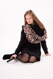 Spy girl in a black coat with gun Stock Photography