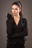 Spy girl in a black with gun Stock Photography