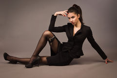 Spy girl in a black with gun. Spy girl in a black suit with gun Stock Photos