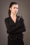 Spy girl in a black with gun. Spy girl in a black suit with gun Royalty Free Stock Images