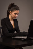 Spy girl in a black with laptop Royalty Free Stock Photo