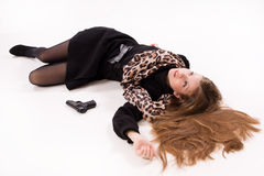 Spy girl with gun lying on the floor. Crime scene imitation. Spy girl with gun lying on the floor Stock Images