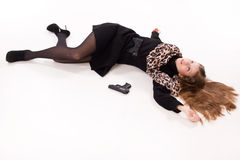 Spy girl with gun lying on the floor Stock Photo