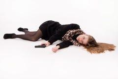 Spy girl with gun lying on the floor. Crime scene imitation. Spy girl with gun lying on the floor Royalty Free Stock Photos