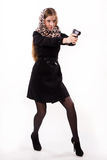 Spy girl shoots a gun Royalty Free Stock Photography