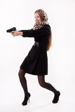 Spy girl shoots a gun Stock Photos