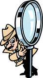 Spy guy. A detective's holding a massive magnifying glass Royalty Free Stock Photography