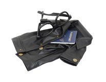 Spy Kit. Consisting of a black leather overcoat, passport and dark glasses - path included Stock Photo