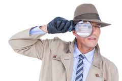 Spy looking through magnifier Stock Images