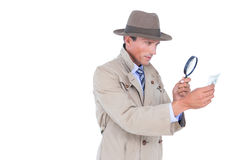 Spy looking through magnifier Stock Photography