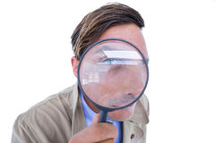 Spy looking through magnifier Stock Image