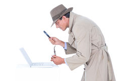 Spy looking through magnifier. On white background Stock Photography