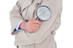 Spy looking through magnifier Royalty Free Stock Photos