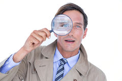 Spy looking through magnifier Royalty Free Stock Photography