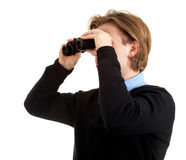 Spy man looking through binoculars Stock Images