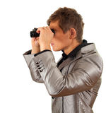 Spy man looking through binoculars Royalty Free Stock Photo