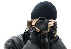 Spy photographer. Dressed in black Stock Image