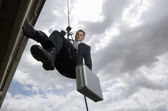 Spy Rappelling with Suitcase Royalty Free Stock Photo