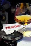 Spy success. Top secret papers. guns and glass of brandy - spy celebrate success Royalty Free Stock Photos
