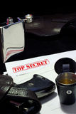 Spy success. Guns, alcohol and top secret papers Royalty Free Stock Image