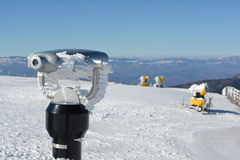 Spy viewing machine and snow guns. On the top of the mountain, winter conditions Royalty Free Stock Photo