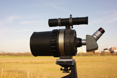 Spyglass. Telescope established on an autumn field, good visibility Stock Photo