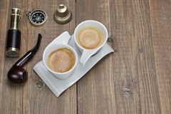 Spyglass, Compass, Smoking Pipe and Two White Espresso Coffee Cu Stock Images