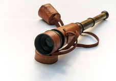 Spyglass with leather. Surrounded by white background Stock Images