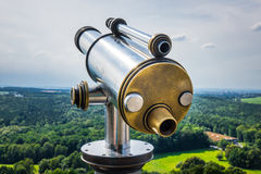 Spyglass on the viewing platform against sky Stock Photos