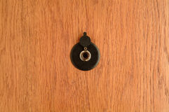The Spyhole. On wooden doors Stock Images