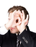 Spying businessman Stock Photography