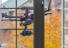 Spying drone. A drone with a camera flying behind an opened bedroom window Stock Photography