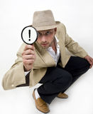 Spying man with magnifying glass Royalty Free Stock Photos
