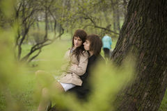 Spying for young couple. Young couple outdoor in the park Royalty Free Stock Images