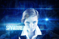Spyware against blue technology interface with circuit board Stock Photo