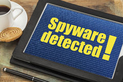 Spyware alert on digital tablet Royalty Free Stock Image