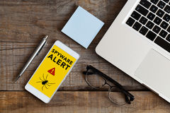 Spyware alert notification in a mobile phone. Stock Photo