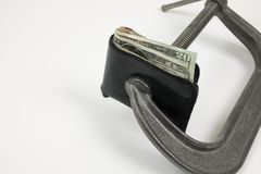 Sqeeze dei soldi. Fotografia Stock