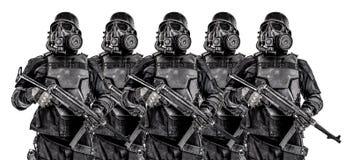 Squad of futuristic nazi soldiers iron line. Line of futuristic nazi soldiers in gas mask and steel helmet with schmeisser handgun isolated on white studio shot stock photos