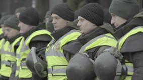 A squad of soldiers of the National Guard of Ukraine in the streets of Kyiv. Stock video footage UHD 4K / 3840-2160 / MP4 / Codec H.264 / 25 fps stock video