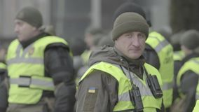 A squad of soldiers of the National Guard of Ukraine in the streets of Kyiv. Stock video footage UHD 4K / 3840-2160 / MP4 / Codec H.264 / 25 fps stock video footage
