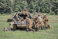 Squad of soviet soldiers capturing a german vehicle Royalty Free Stock Images