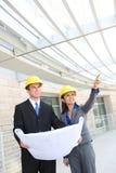 Squadra della costruzione della donna e dell'uomo Fotografia Stock