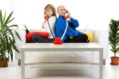 Squadra di affari che comunica sul telefono Fotografie Stock