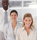 Squadra di affari che mostra spirito Immagine Stock